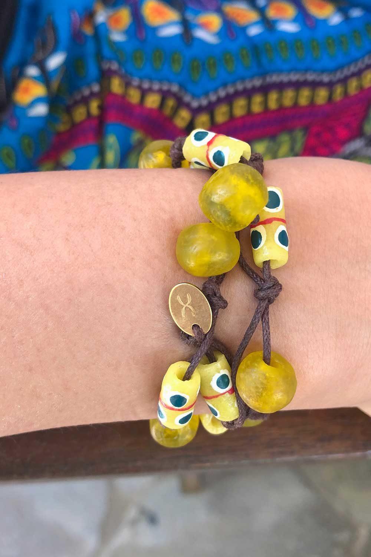 Yellow Bead Jiona Bracelet Brown Cord Modelled by SHIKHAZURI
