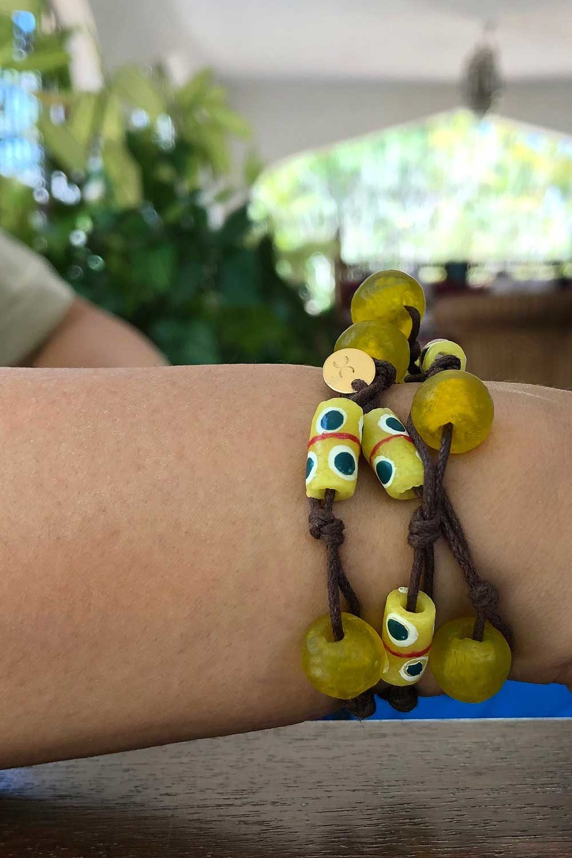 Yellow Jiona Knot Bracelet Brown Cord by SHIKHAZURI Model