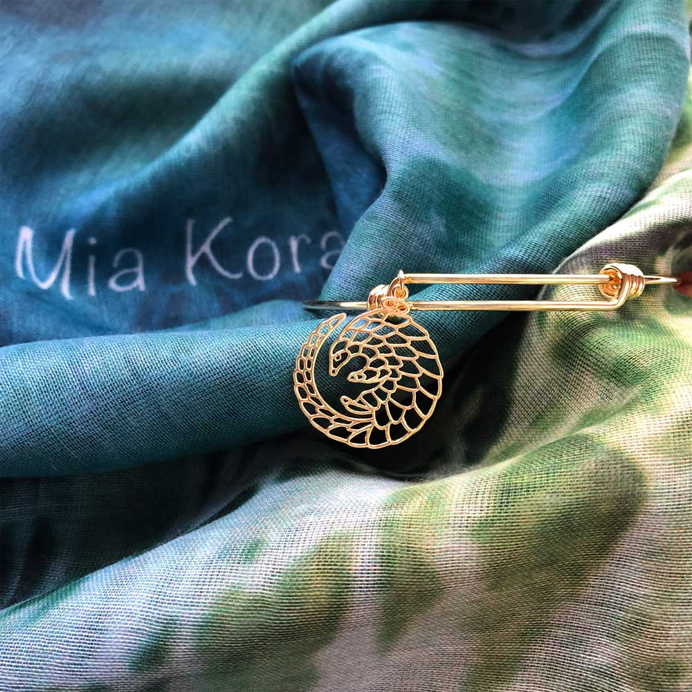 SHIKHAZURI Pangolin Gold Bangle on Mia Kora Scarf