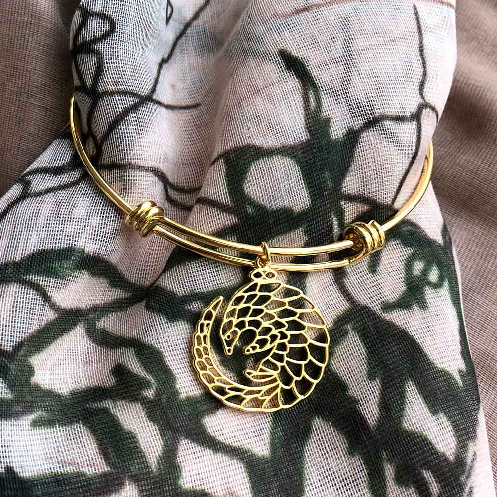 Pangolin Gold Bangle by SHIKHAZURI and Mia Kora Scarf